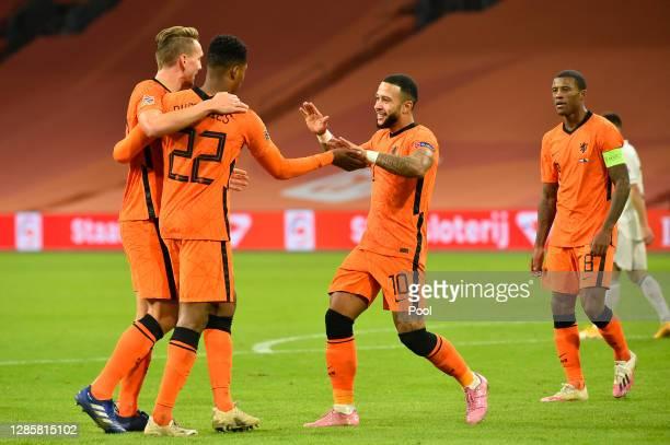 Memphis Depay of Netherlands celebrates with teammates Luuk de Jong, Denzel Dumfries and Georginio Wijnaldum of Netherlands after scoring his team's...