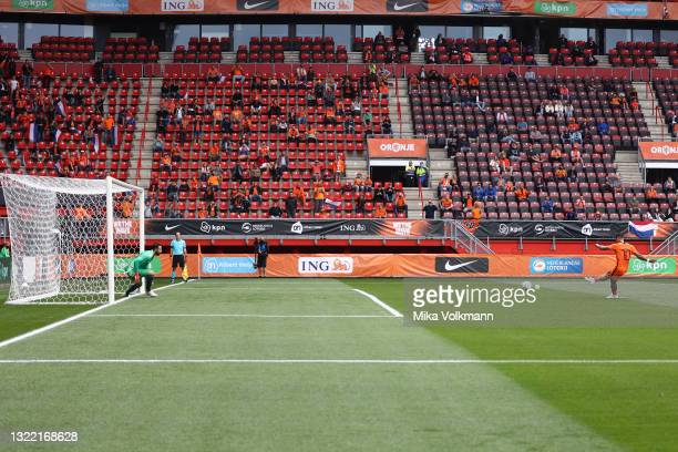 Memphis Depay of Netherlands scores their side's first goal from the penalty spot past Giorgi Loria of Georgia during the international friendly...