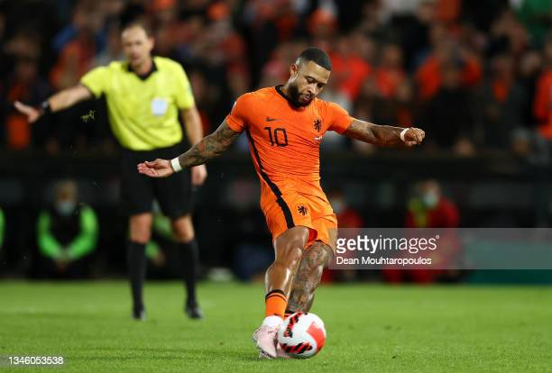 Memphis Depay of Netherlands scores their team's third goal from the penalty spot during the 2022 FIFA World Cup Qualifier match between Netherlands...