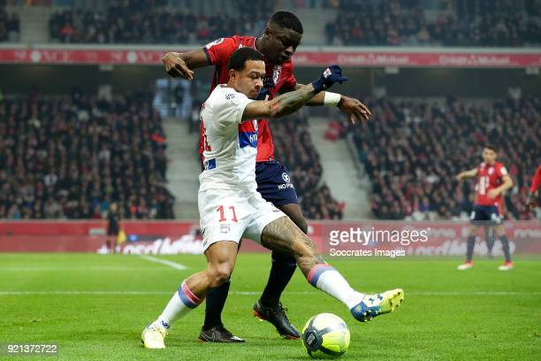Memphis Depay of Olympique Lyon Bakary Soumaoro of Lille during the French League 1 match between Lille v Olympique Lyon at the Stade Pierre Mauroy...