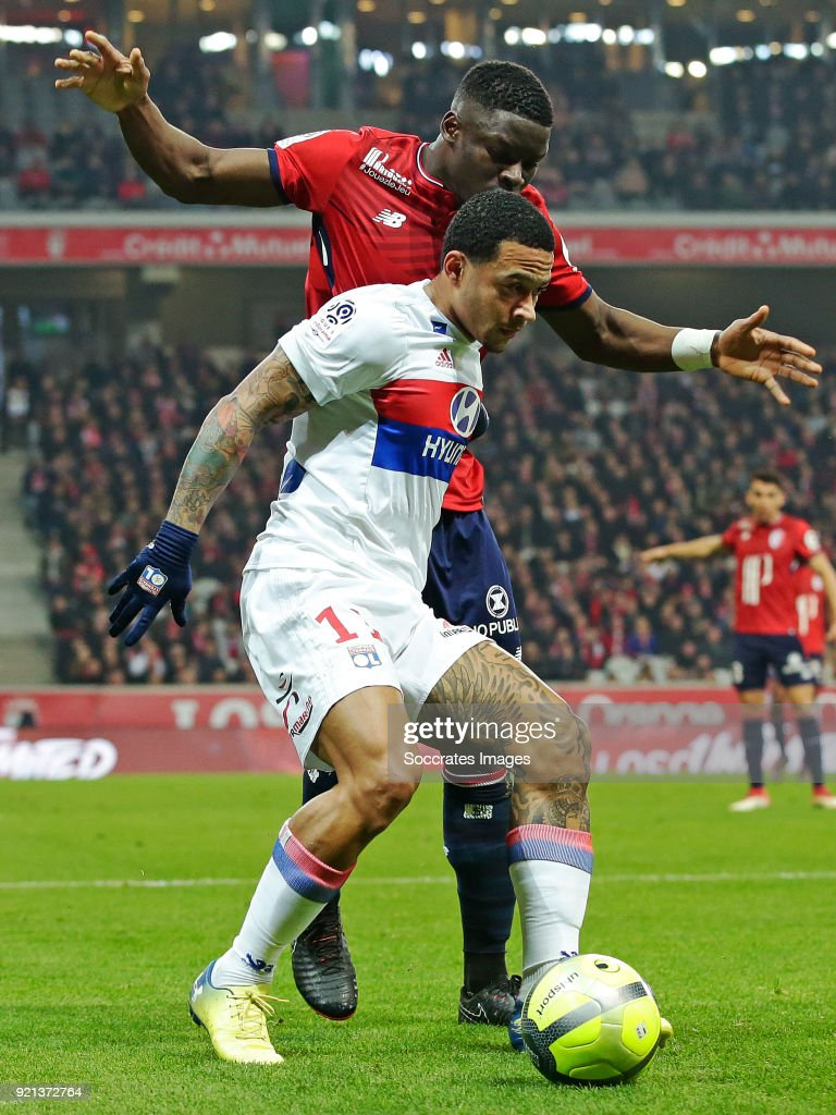 Memphis Depay of Olympique Lyon, Bakary Soumaoro of Lille during the French League 1 match between Lille v Olympique Lyon at the Stade Pierre Mauroy on February 18, 2018 in Lille France