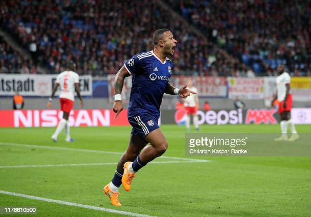 Memphis Depay of Olympique Lyon celebrates after scoring his sides first goal during the UEFA Champions League group G match between RB Leipzig and...