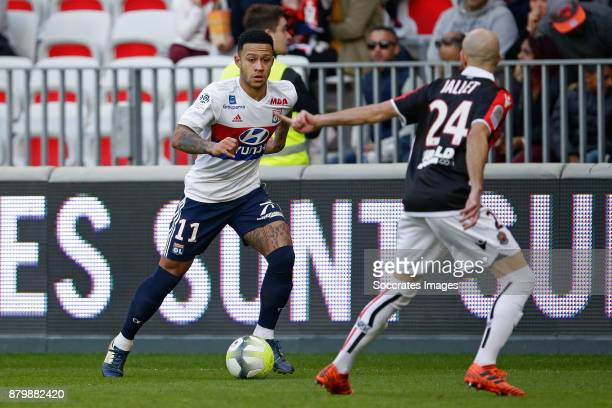 Memphis Depay of Olympique Lyon Christophe Jallet of Nice during the French League 1 match between Nice v Olympique Lyon at the Allianz Riviera on...