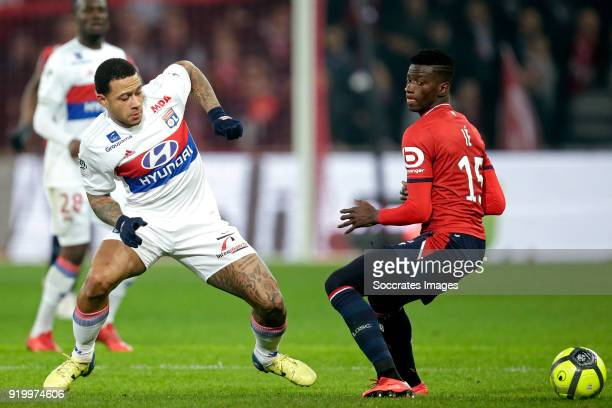 Memphis Depay of Olympique Lyon Edgar Le of Lille during the French League 1 match between Lille v Olympique Lyon at the Stade Pierre Mauroy on...