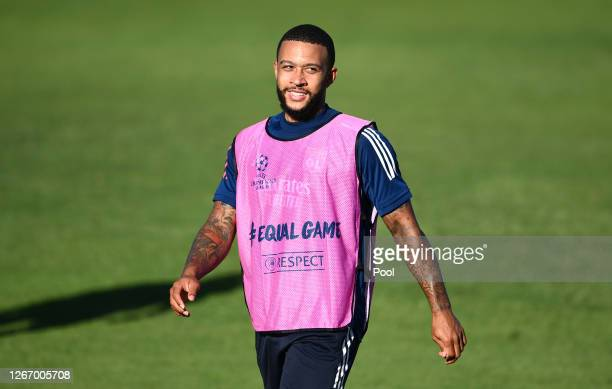 Memphis Depay of Olympique Lyon looks on during a training session ahead of their UEFA Champions League Semi Final match against Bayern Munich at...