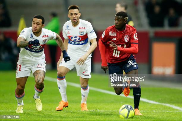 Memphis Depay of Olympique Lyon Nicolas Pepe of Lille during the French League 1 match between Lille v Olympique Lyon at the Stade Pierre Mauroy on...