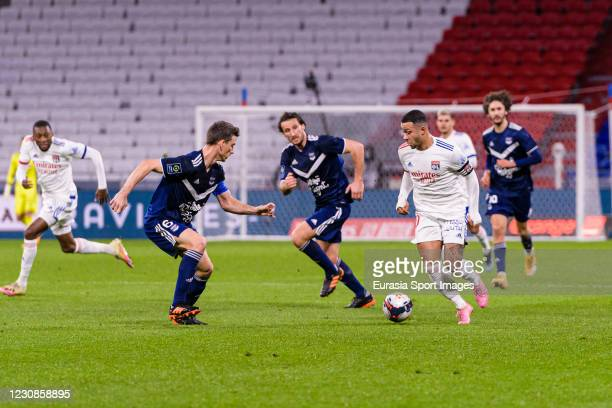 Memphis Depay of Olympique Lyon plays against Laurent Koscienly of Bordeaux during the match between Olympique Lyonnais and Bordeaux at Groupama...
