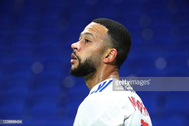 Memphis Depay of Olympique Lyon reacts during the Ligue 1 match between Olympique Lyon and Olympique Marseille at Groupama Stadium on October 4, 2020...