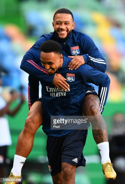 Memphis Depay of Olympique Lyon smiles during the Olympique Lyonnais Training Session ahead of the UEFA Champions League match between Manchester...