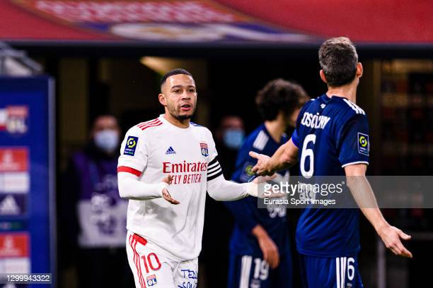 Memphis Depay of Olympique Lyon talks to Laurent Koscienly of Bordeaux during the match between Olympique Lyonnais and Bordeaux at Groupama Stadium...