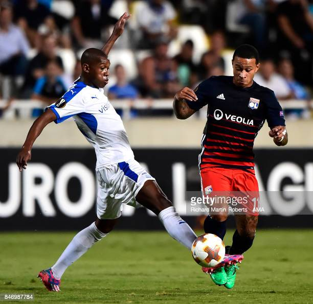 Memphis Depay of Olympique Lyonnais competes with Alef of Apollon Limassol during the UEFA Europa League group E match between Apollon Limassol and...