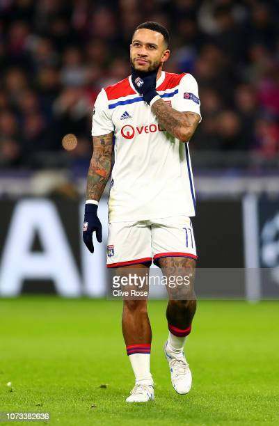 Memphis Depay of Olympique Lyonnais looks on during the Group F match of the UEFA Champions League between Olympique Lyonnais and Manchester City at...