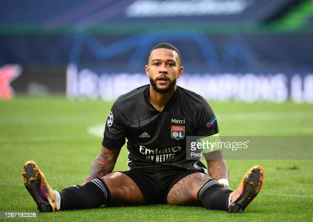 Memphis Depay of Olympique Lyonnais reacts after a missed chance during the UEFA Champions League Semi Final match between Olympique Lyonnais and...