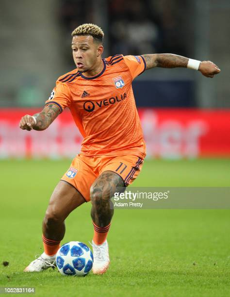 Memphis Depay of Olympique Lyonnais runs with the ball during the Group F match of the UEFA Champions League between TSG 1899 Hoffenheim and...