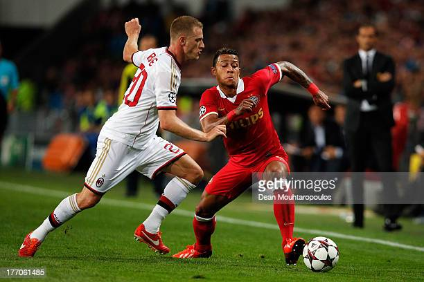 Memphis Depay of PSV and Ignazio Abate of AC Milan battle for the ball during the UEFA Champions League Playoff First Leg match between PSV Eindhoven...