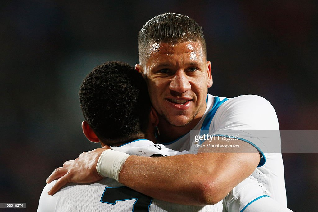 Memphis Depay (#7) of PSV celebrates with team mate Jeffrey Bruma (R) after he scores the fifth goal of the game during the Dutch Eredivisie match between FC Twente and PSV Eindhoven held at De Grolsch Veste Stadium on April 4, 2015 in Enschede, Netherlands.