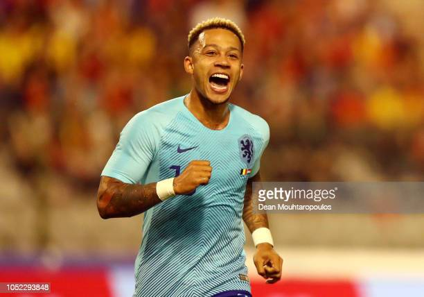 Memphis Depay of the Netherlands celebrates after providing an assist for Arnaut Groeneveld of the Netherlands who then scores their team's first...