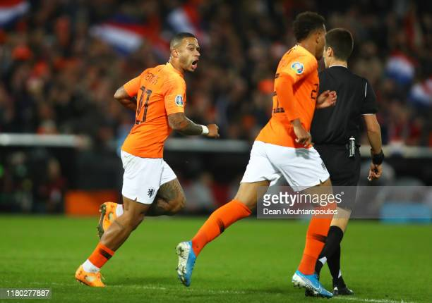 Memphis Depay of the Netherlands celebrates after scoring his sides first goal during the UEFA Euro 2020 qualifier between Netherlands and Northern...