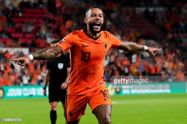 Memphis Depay of the Netherlands celebrates after scoring his sides second goal during the 2022 FIFA World Cup Qualifier match between Netherlands...