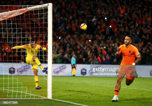 Memphis Depay of the Netherlands celebrates after scoring his team's second goal from the penalty spot as Hugo Lloris of France reacts during the...