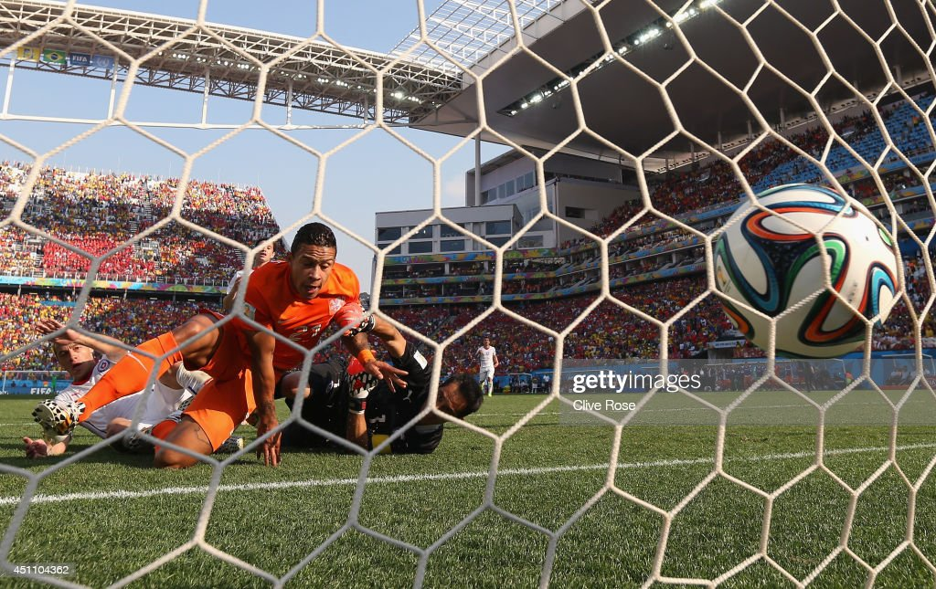 Memphis Depay of the Netherlands celebrates as he beats goalkeeper Claudio Bravo of Chile to score their second goal during the 2014 FIFA World Cup Brazil Group B match between the Netherlands and Chile at Arena de Sao Paulo on June 23, 2014 in Sao Paulo, Brazil.
