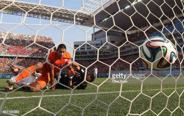 Memphis Depay of the Netherlands celebrates as he beats goalkeeper Claudio Bravo of Chile to score their second goal during the 2014 FIFA World Cup...
