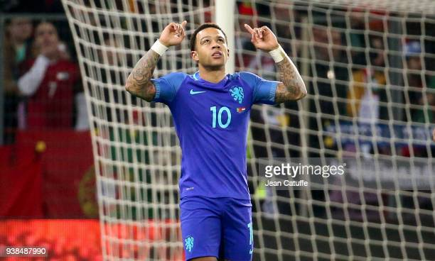 Memphis Depay of the Netherlands celebrates his goal during the international friendly match between Portugal and the Netherlands at Stade de Geneve...