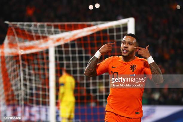 Memphis Depay of the Netherlands celebrates scoring his teams second goal of the game during the UEFA Nations League A group one match between...
