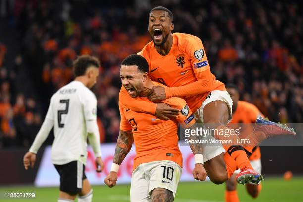 Memphis Depay of the Netherlands celebrates scoring his team's second goal with teammate Georginio Wijnaldum during the 2020 UEFA European...