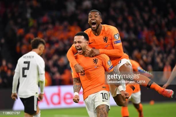 Memphis Depay of the Netherlands celebrates scoring his team's second goal with teammate Georginio Wijnaldum during the 2020 UEFA European...