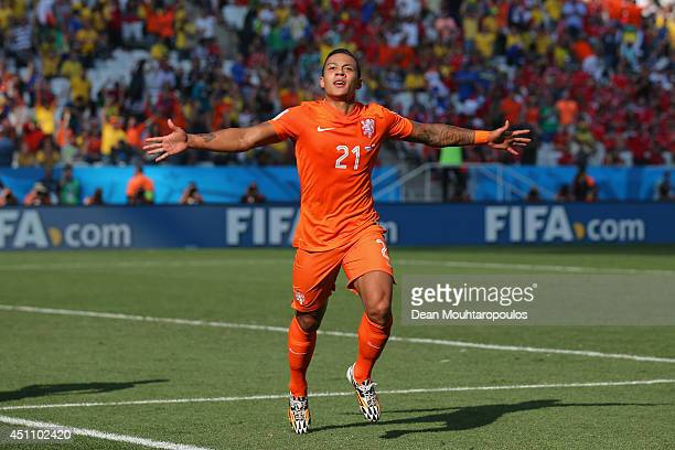 Memphis Depay of the Netherlands celebrates scoring his team's second goal during the 2014 FIFA World Cup Brazil Group B match between the...