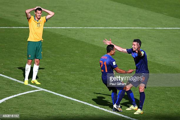Memphis Depay of the Netherlands celebrates scoring his team's third goal with Robin van Persie as Ryan McGowan of Australia looks on during the 2014...