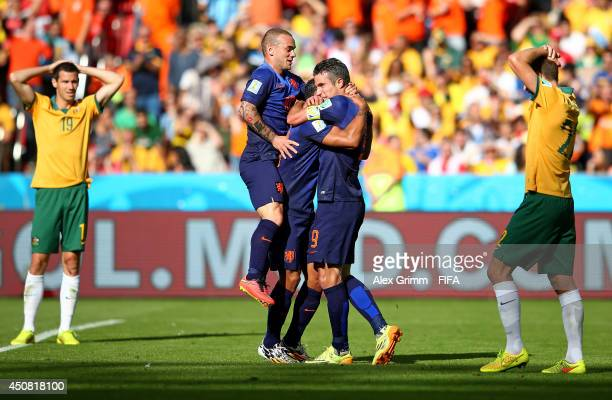 Memphis Depay of the Netherlands celebrates with team-mates after scoring the team's third goal during the 2014 FIFA World Cup Brazil Group B match...