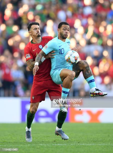 Memphis Depay of the Netherlands is put under pressure by Jose Fonte of Portugal during the UEFA Nations League Final between Portugal and the...