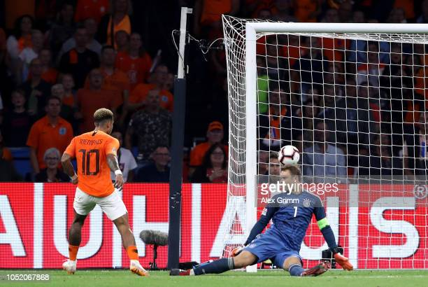 Memphis Depay of the Netherlands scores his sides second goal during the UEFA Nations League A group one match between Netherlands and Germany at...