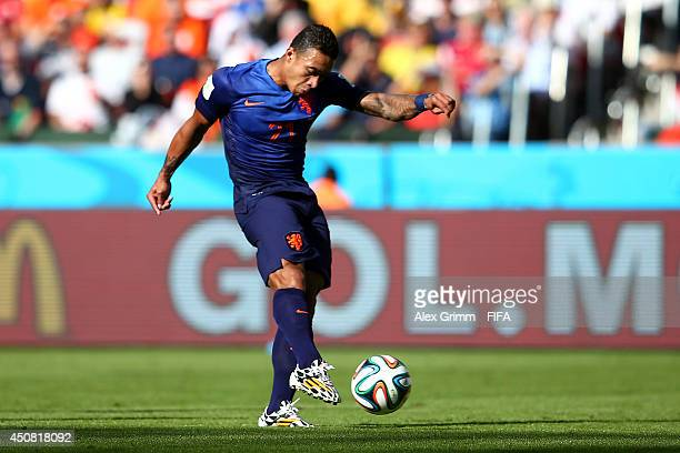 Memphis Depay of the Netherlands scores the team's third goal during the 2014 FIFA World Cup Brazil Group B match between Australia and Netherlands...