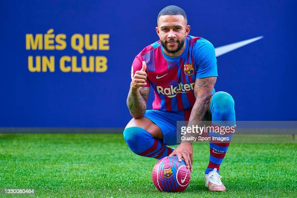 Memphis Depay poses for a photograph during his unveiling at Camp Nou on July 22, 2021 in Barcelona, Spain.