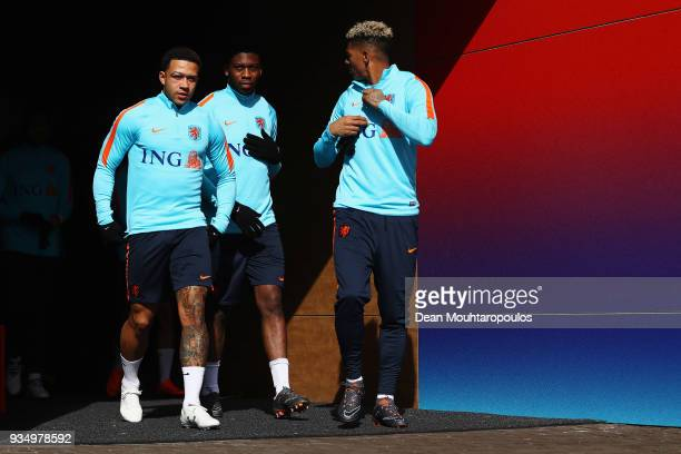Memphis Depay Timothy FosuMensah and Patrick van Aanholt of the Netherlands walk out the players tunnel during the Netherlands Training session held...