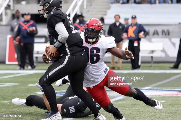 Memphis Express linebacker Anthony Johnson sacks Birmingham Iron quarterback Luis Perez during the game between the Birmingham Iron and the Memphis...