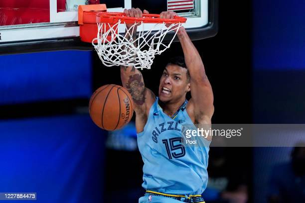 Memphis Grizzlies' Brandon Clarke dunks against the San Antonio Spurs during the first half of an NBA basketball game at Visa Athletic Center at ESPN...