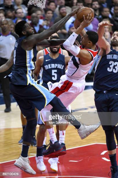 Memphis Grizzlies forward James Ennis III fouls Washington Wizards forward Otto Porter Jr on December 13 2017 at the Capital One Arena in Washington...