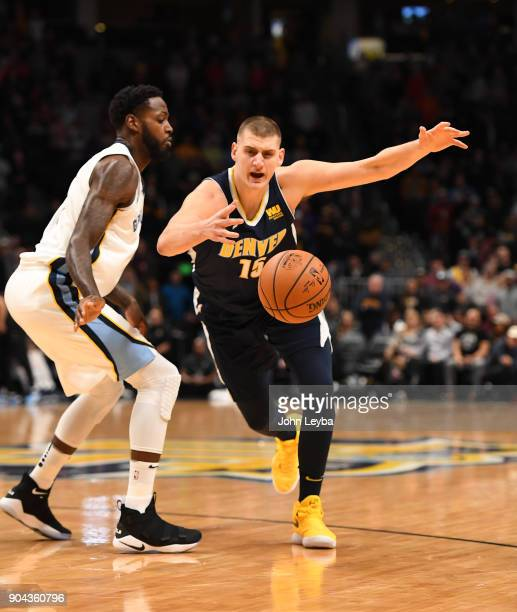 Memphis Grizzlies forward JaMychal Green knocks the ball away from Denver Nuggets center Nikola Jokic during the first quarter on January 12 2018 at...