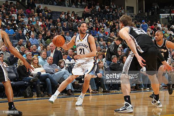 Memphis Grizzlies guard Greivis Vasquez protects the ball during the game against the San Antonio Spurs on March 27 2011 at FedExForum in Memphis...