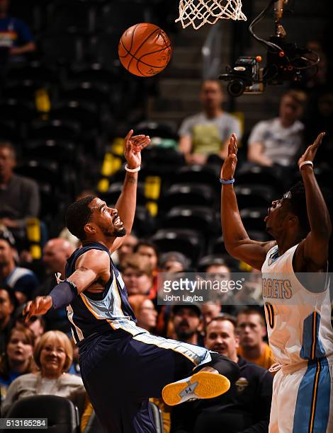 Memphis Grizzlies guard Mike Conley loses the ball in front of Denver Nuggets guard Emmanuel Mudiay February 29 2016 at Pepsi Center