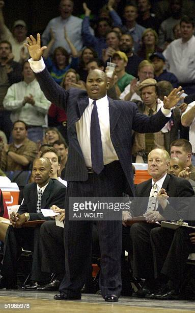 Memphis Grizzlies' head coach Sidney Lowe coaches from the sidelines during the fourth quarter of the Grizzlies' 9080 loss to the Detroit Pistons at...