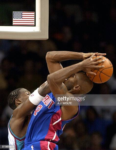Memphis Grizzlies Lorenzen Wright fouls Detroit Piston's Jerry Stackhouse during the fourth quarter of the Piston's 9080 win over the Grizzlies 01...