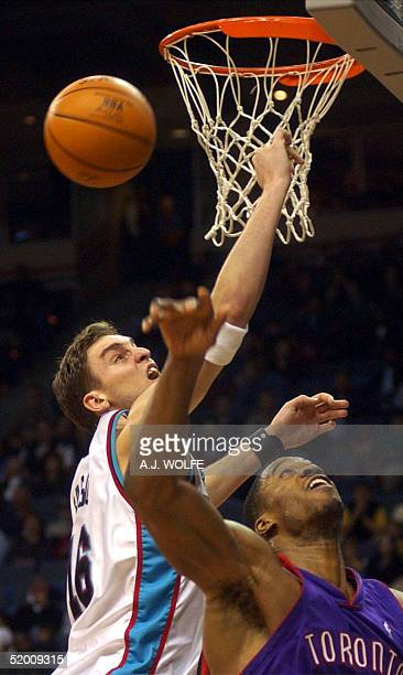 Memphis Grizzlies' Pau Gasol of Spain and Toronto Raptors' Antonio Davis go for a loose ball during the third quarter 01 December 2002 at The Pyramid...