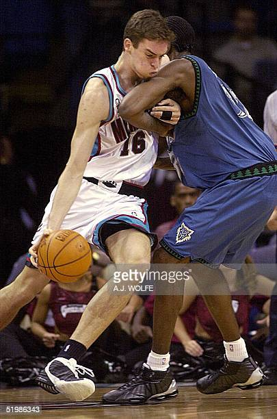 Memphis Grizzlies' Pau Gasol of Spain drives to the basket against Minnesota Timberwolves' Joe Smith during the first quarter 06 December 2001 at The...