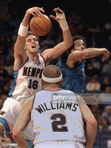 Memphis Grizzlies' Pau Gasol of Spain grabs a rebound from Minnesota Timberwolves' Loren Woods during the first quarter 15 November 2001 at the...