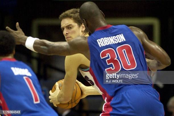 Memphis Grizzlies' Pau Gasol of Spain is guarded by Detroit Pistons' Clifford Robinson in the third quarter of the Pistons 9080 win at the Pyramid in...